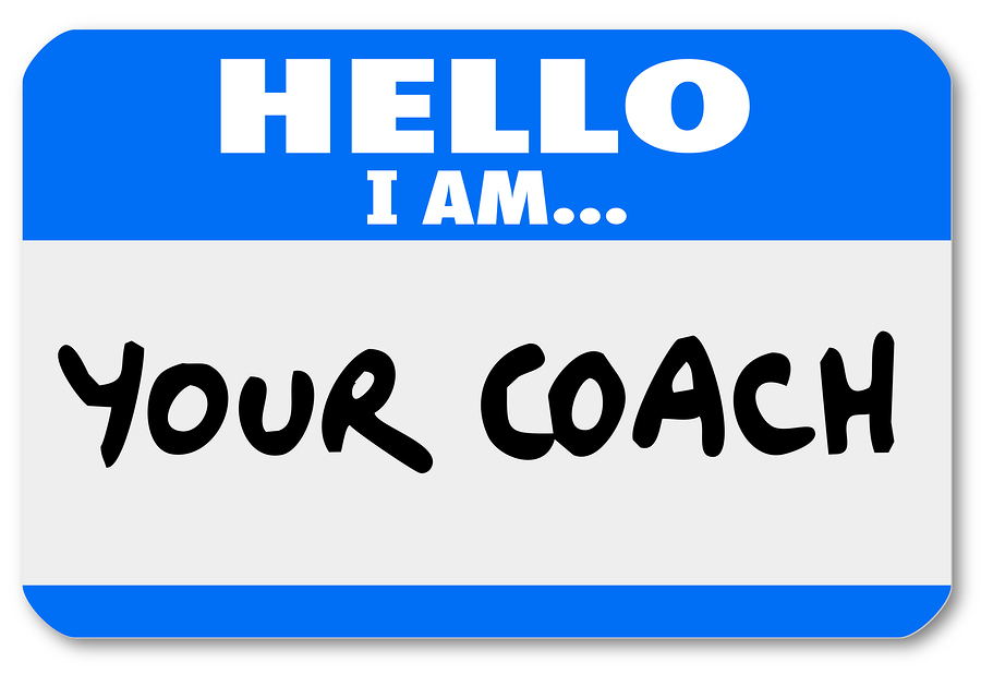 A namtag sticker with the words Hello I Am Your Coach to represe